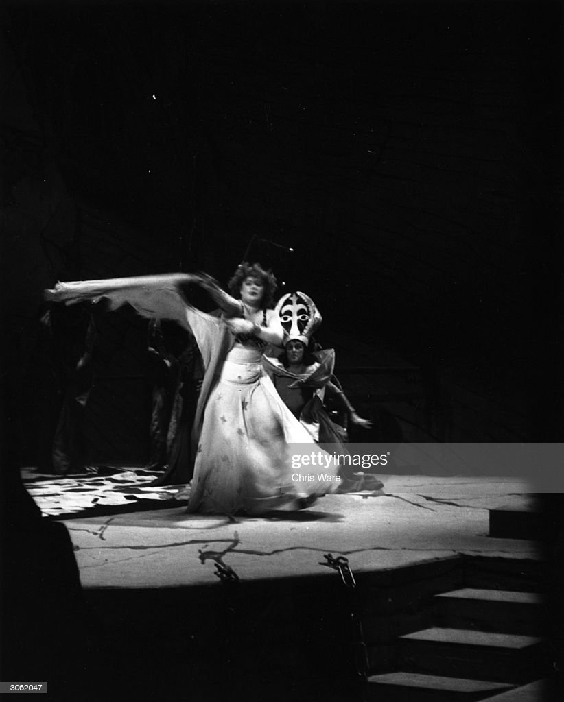 Bulgarian soprano Ljuba Welitsch (1913 - 1996) charms Herod, played by Franz Lechleichner, into giving her the head of John the Baptist by performing the 'Dance of the Seven Veils'. She is playing the lead in a controversial production of Richard Strauss's opera 'Salome', at the Royal Opera House, Covent Garden. Producer Peter Brook, costumes & sets designed by Salvador Dali. It was abandoned after six performances.