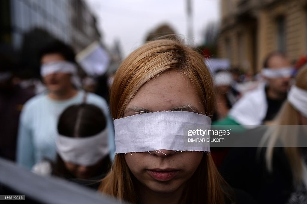 Bulgarian students with bandages covering their eyes attend a protest in Sofia on November 1, 2013. Students marching in Bulgarian capital called for the beleaguered Socialist-backed government's ousting, amid continuing protests and occupations in universities around the country.
