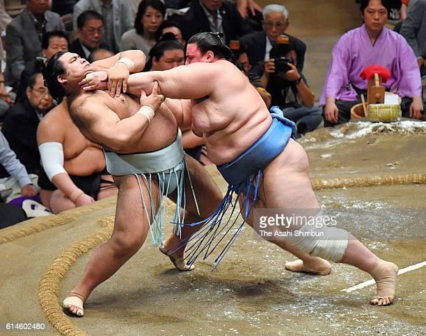 Bulgarian wrestler Aoiyama pushes sekiwake Takayasu out of the ring to win during final day of the Grand Sumo Autumn Tournament at Ryogoku Kokugikan...
