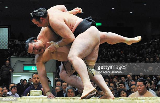 Bulgarian wrestler Kotooshu whose real name is Kaloyan Stefanov Mahlyanov pushes out Kisenosato during day twelve of the Grand Sumo New Year...