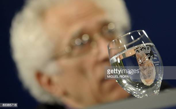 Bulgarianborn French philosopher Tzvetan Todorov is reflected in a wine glass during a press conference in Oviedo on October 22 2008 Todorov has been...
