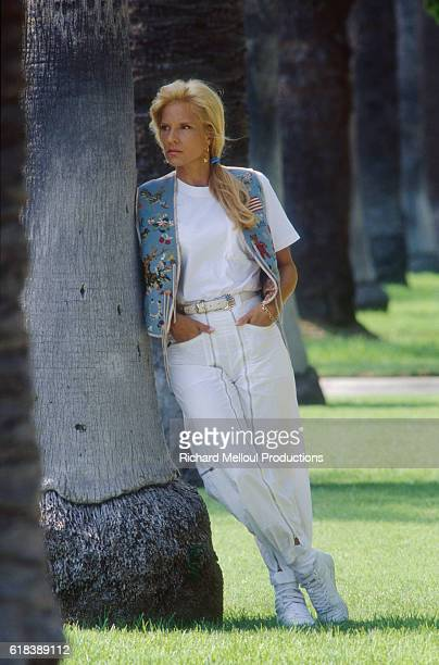 Bulgarianborn French singer Sylvie Vartan leans against a tree in Los Angeles