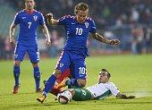 Bulgaria's Defender Iliya Milanov vies with Croatia's Midfielder Luka Modric during the Euro 2016 group H qualifying football match between Bulgaria...