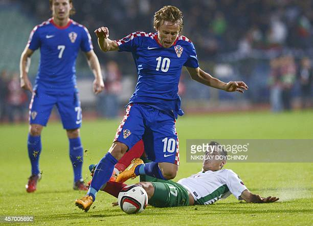 Bulgaria's Defender Iliya Milanov vies with Croatia's Midfielder Luka Modric during the Euro 2016 group H qualifying football match between Bulgaria...