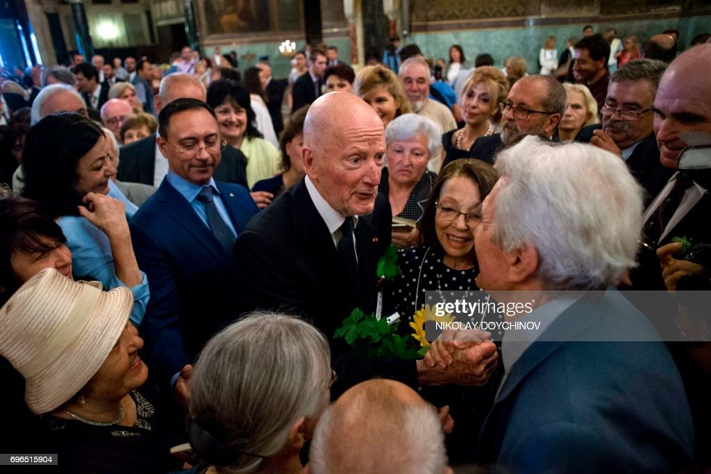 Bulgaria's ex-King and former Prime Minister Simeon Saxe-Coburg-Gotha (C) and his wife Margarita Gomez Acebo (C) are congratulated by people after a mass to celebrate his 80th birthday at the golden-domed Alexander Nevski Cathedral in Sofia, on June 16, 2017. /