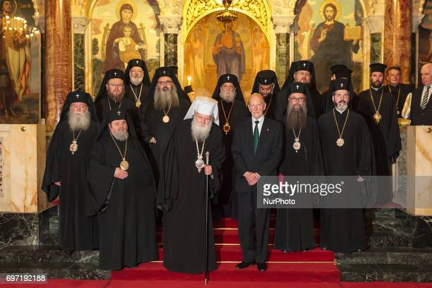 Bulgaria's exKing and former Prime Minister Simeon SaxeCoburgGotha poses with Bulgaria's Orthodox Church Patriarch Neophyte and priests during an...