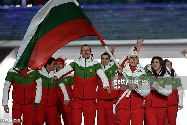 Bulgaria's flag bearer alpine skier Maria Kirkova leads her national delegation during the Opening Ceremony of the 2014 Sochi Winter Olympics at the...