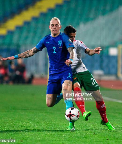 Bulgaria's Forward Alexandar Tonev vies with Netherland's defender Rick Karsdorp during the FIFA World Cup 2018 qualification football match between...