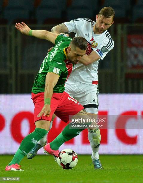 Bulgaria's forward Andrej Galabinov and Belarus' defender Mikhail Sivakov vie for the ball during the FIFA 2018 World Cup football qualifier match...