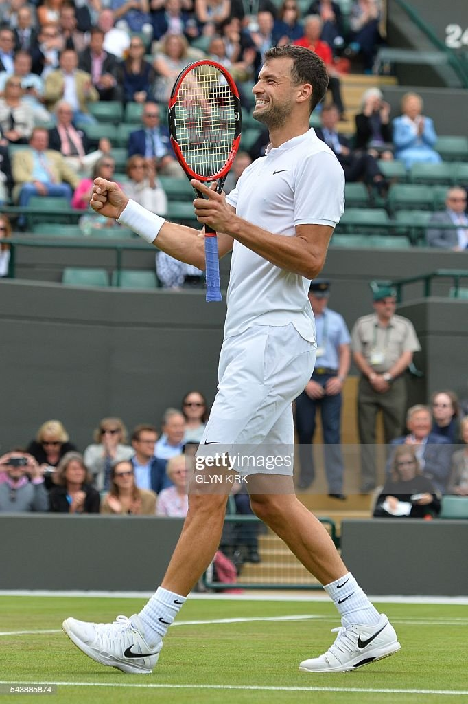 Bulgaria's Grigor Dimitrov celebrates beating France's Gilles Simon in their men's singles second round match on the fourth day of the 2016 Wimbledon Championships at The All England Lawn Tennis Club in Wimbledon, southwest London, on June 30, 2016. / AFP / GLYN