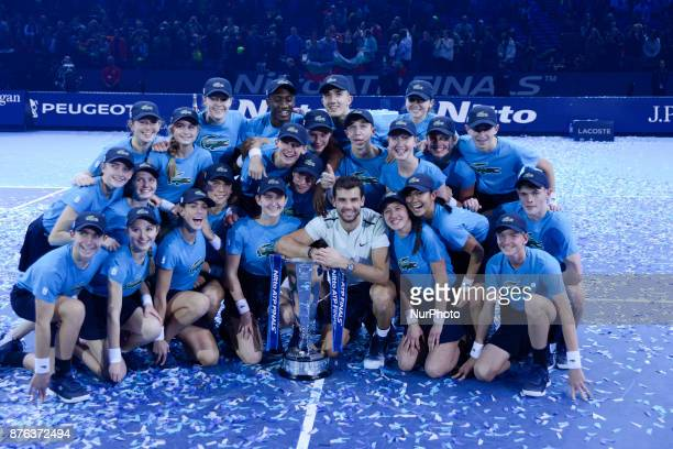 Bulgaria's Grigor Dimitrov holds the trophy as he celebrates winning his men's singles final match against Belgium's David Goffin on day eight of the...
