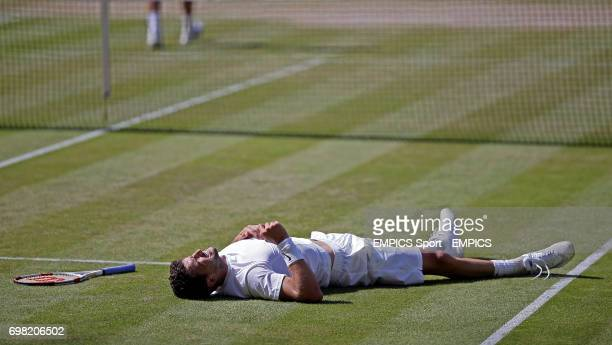 Bulgaria's Grigor Dimitrov lies on the ground after slipping during his match against Serbia's Novak Djokovic