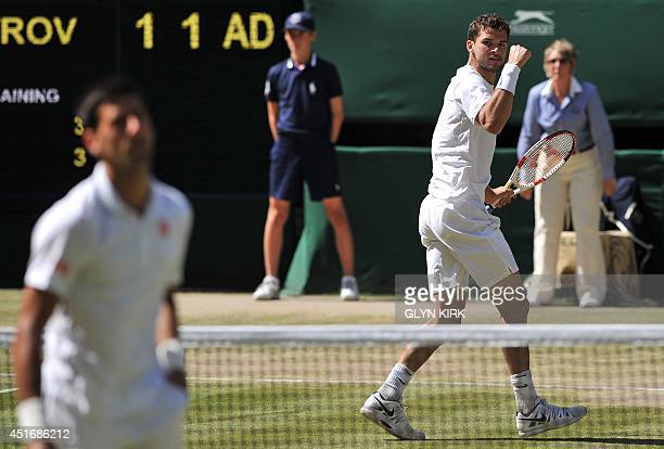 Bulgaria's Grigor Dimitrov reacts to winning a point after hitting a ball that passed Serbia's Novak Djokovic at the net during their men's singles...