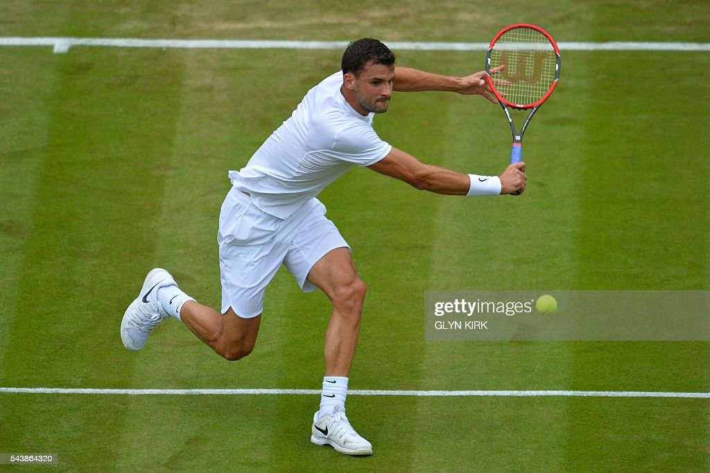 Bulgaria's Grigor Dimitrov returns against France's Gilles Simon during their men's singles second round match on the fourth day of the 2016 Wimbledon Championships at The All England Lawn Tennis Club in Wimbledon, southwest London, on June 30, 2016. / AFP / GLYN
