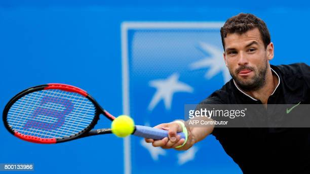 Bulgaria's Grigor Dimitrov returns against Russia's Daniil Medvedev during their men's singles quarterfinal tennis match at the ATP Aegon...