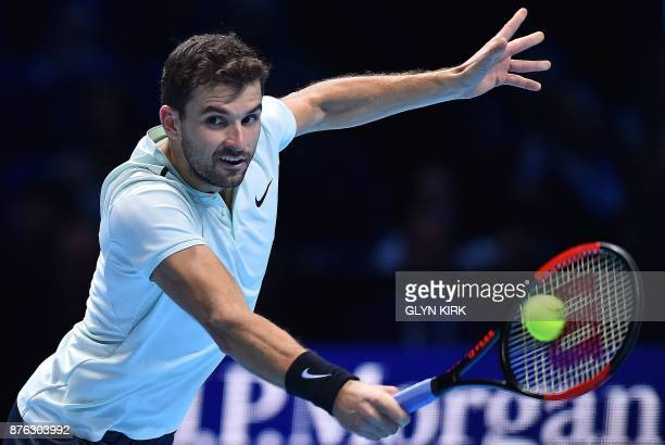 Bulgaria's Grigor Dimitrov returns to Belgium's David Goffin during their men's singles final match on day eight of the ATP World Tour Finals tennis...