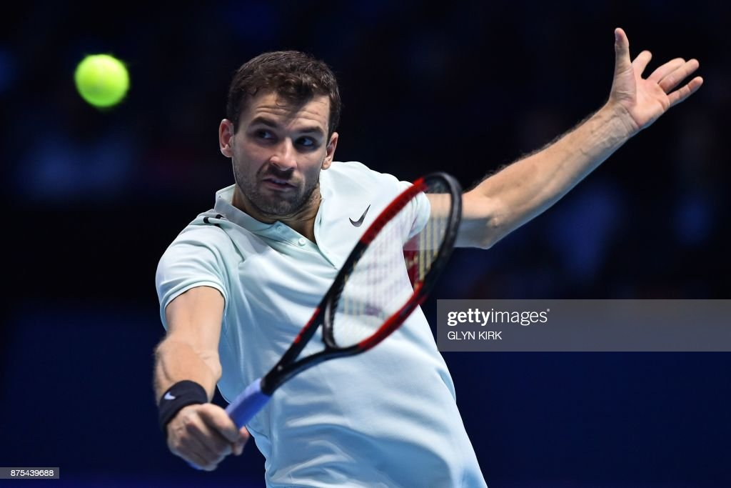 Bulgaria's Grigor Dimitrov returns to Spain's Pablo Carreno Busta during their men's singles round-robin match on day six of the ATP World Tour Finals tennis tournament at the O2 Arena in London on November 17, 2017. / AFP PHOTO / Glyn KIRK