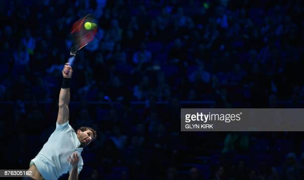 Bulgaria's Grigor Dimitrov serves to Belgium's David Goffin during their men's singles final match on day eight of the ATP World Tour Finals tennis...