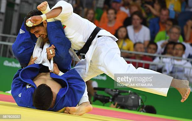 Bulgaria's Ivaylo Ivanov competes with South Korea's Lee Seungsu during their men's 81kg judo contest match of the Rio 2016 Olympic Games in Rio de...