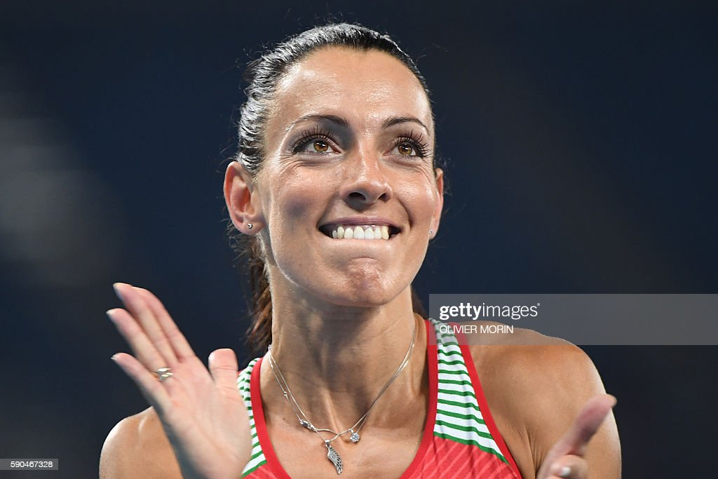 Bulgaria's Ivet LalovaCollio applauds after competing in the Women's 200m Semifinal during the athletics event at the Rio 2016 Olympic Games at the...