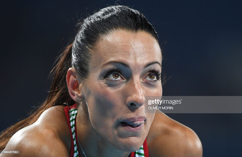 Bulgaria's Ivet LalovaCollio reacts after competing in the Women's 200m Semifinal during the athletics event at the Rio 2016 Olympic Games at the...