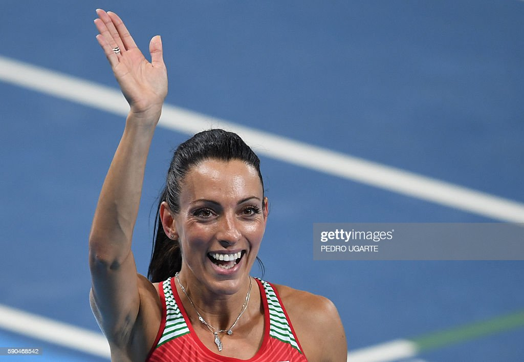Bulgaria's Ivet LalovaCollio waves after competing in the Women's 200m Semifinal during the athletics event at the Rio 2016 Olympic Games at the...