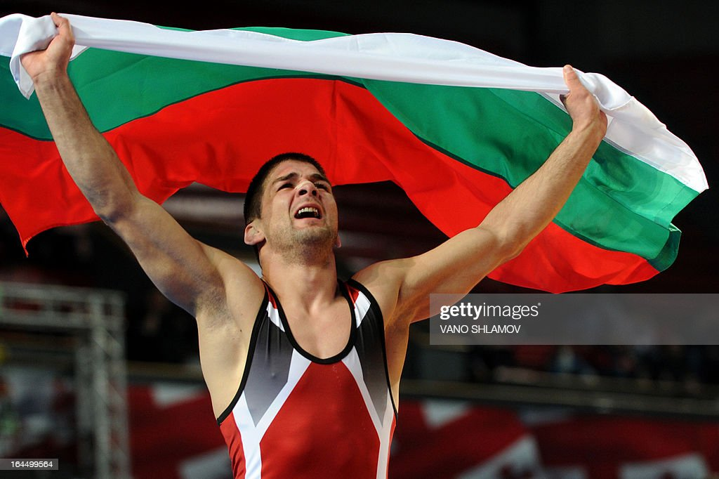 Bulgaria's Ivo Angelov celebrates after winning a gold medal during the Greco-Roman Wrestling 60kg gold medal match against Russia's Ivan Kuylakov at the Senior Wrestling European Championship in Tbilisi, March 23, 2013.