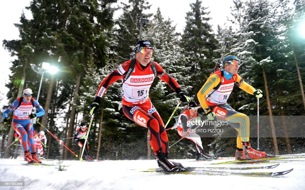 Bulgaria's Michail Kletcherov (2nd R) and Kazakhstan's Alexsandr Chervykhov (R) compete during the men 4x7,5 Km relay as part of IBU Biathlon World Championships in Nove Mesto, Czech Republic, on February 16, 2013. Norway won the race ahead of France and Germany.