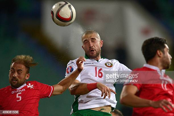 Bulgaria's Midfielder Andrej Galabinov and Malta's Defender Andrei Agius go for a header during the Euro 2016 group H qualifying football match...