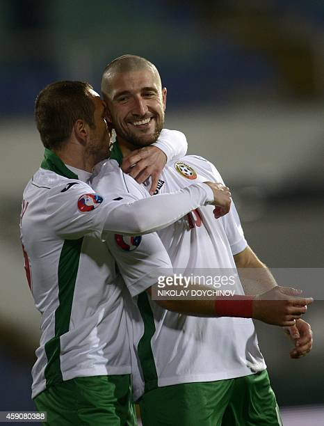 Bulgaria's midfielder Andrej Galabinov celebrates with teammate after scoring during the Euro 2016 group H qualifying football match between Bulgaria...