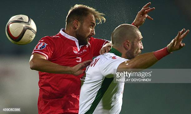 Bulgaria's Midfielder Andrej Galabinov heads the ball against Malta's Defender Andrei Agius during the Euro 2016 group H qualifying football match...