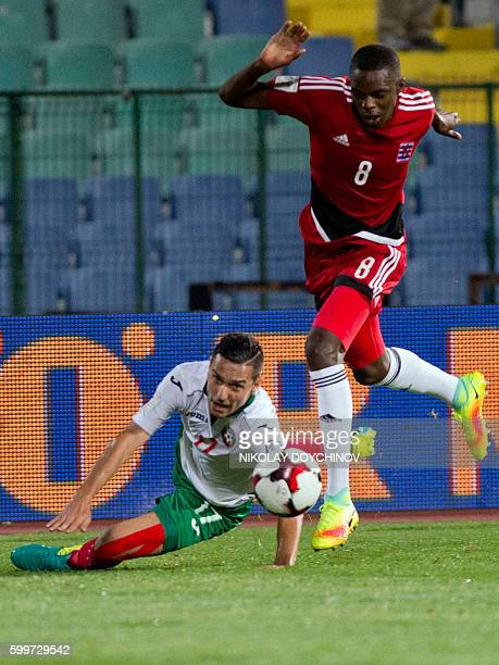 Bulgaria's midfielder Georgi Milanov vies with Luxembourg's midfielder Christopher Martins Pereira during the FIFA World Cup 2018 football...