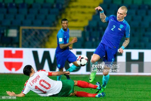 Bulgaria's Midfielder Ivelin Popov vies with Netherland's defender Rick Karsdorp during the FIFA World Cup 2018 qualification football match between...