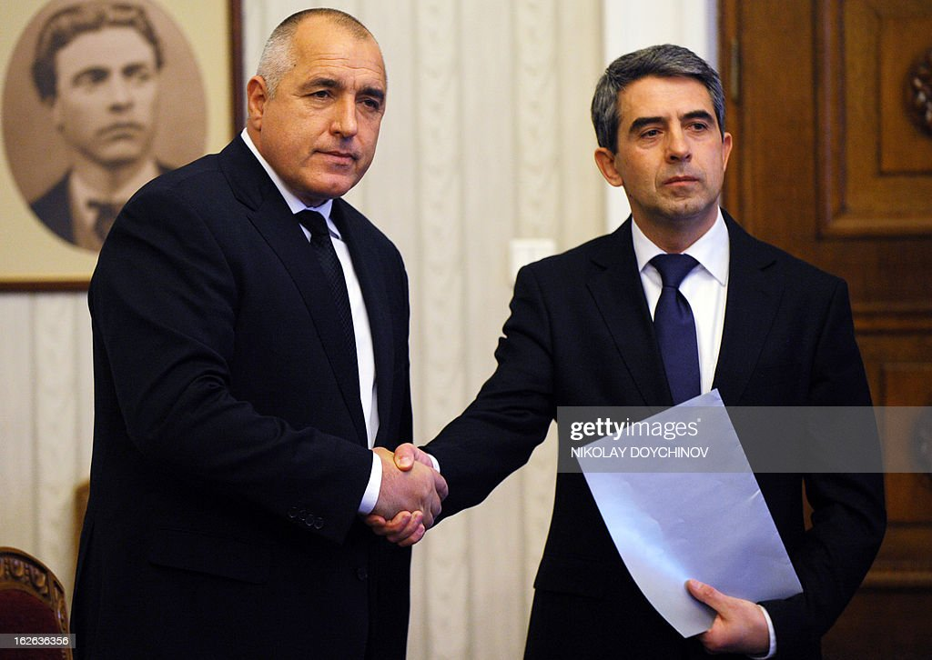 Bulgaria's outgoing Prime Minister Boyko Borisov (L) turns down a mandate for new cabinet to President Rosen Plevneliev at the presidency in Sofia on February 25, 2013. Bulgaria's outgoing Prime Minister Borisov turned down on Monday a presidential mandate to form a new cabinet, opening the way for snap elections after being forced out by protests last week.