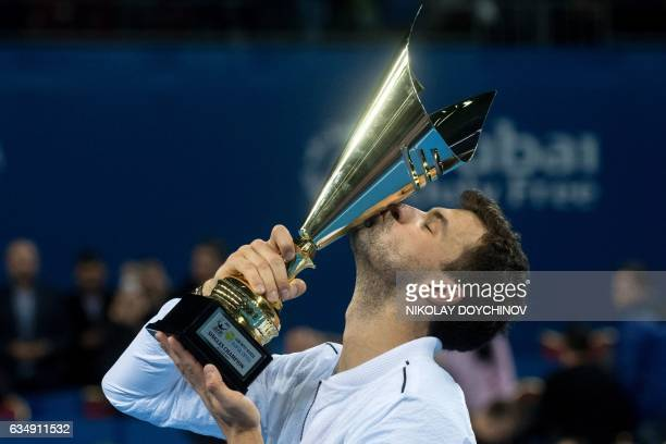 Bulgaria's player Grigor Dimitrov kisses his trophy after winning the final tennis match against Belgium's player David Goffin during the ATP Garanti...