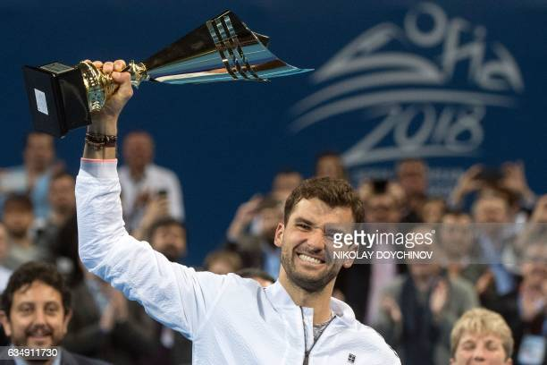 Bulgaria's player Grigor Dimitrov poses with his trophy after winning the final tennis match against Belgium's player David Goffin during the ATP...