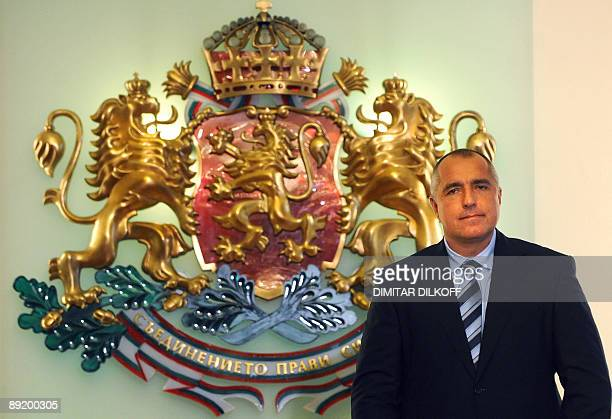 Bulgaria's premier elect black belt Sofia mayor Boyko Borisov poses as he unveils to President Georgy Parvanov the names of his minority cabinet of...
