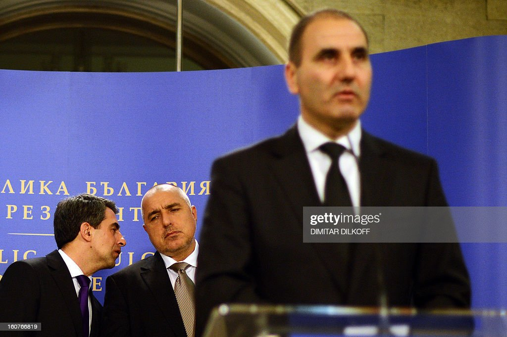 Bulgaria's President Rossen Plevneliev (L) speaks to Prime minister Boiko Borisov as Interior Minister Tsvetan Tsvetanov (R) speaks during a press conference, after a national security conference in Sofia on February 5, 2013. The Bulgarian government said that two people with Canadian and Australian passports linked to the Lebanese militia movement Hezbollah were behind a bomb attack on Bulgaria's Black Sea coast in July that killed five Israeli tourists.