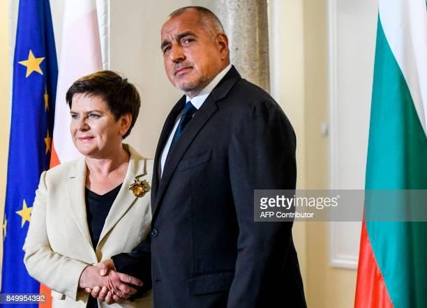 Bulgaria's Prime Minister Boyko Borisov and his Polish counterpart Beata Szydlo shake hands prior to their meeting in Sofia on September 20 2017 /...