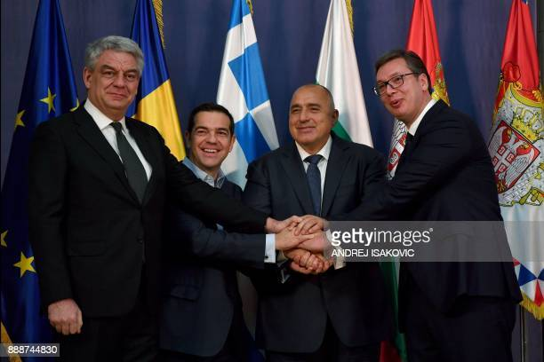 Bulgaria's Prime Minister Boyko Borisov Greece's Prime Minister Alexis Tsipras and Romania's Prime Minister Mihai Tudose shake hands with Serbian...