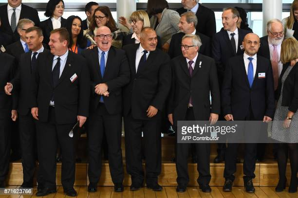 Bulgaria's Prime Minister Boyko Borissov poses with European Commission President JeanClaude Juncker and EU Commission VicePresident Frans Timmermans...