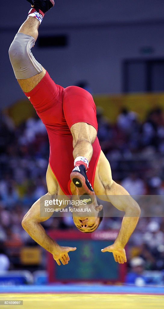 Bulgaria's Radoslav Velikov performs a flip after his victory over Azerbaijan's Namig Sevdimov (not in photo) in their 2008 Beijing Olympic Games wrestling men's 55kg freestyle bronze medal contest at the China Agricultural University Gymnasium in Beijing on August 19, 2008. Velikov won the match.