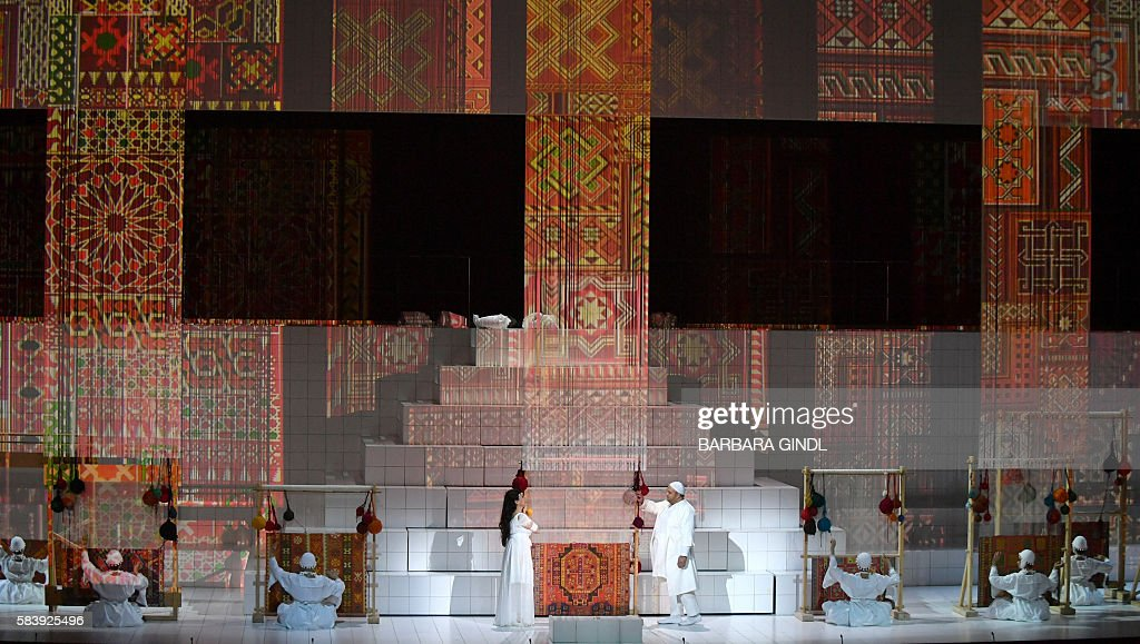 Bulgaria's soprano Krassimira Stoyanova in the role of 'Danae' and Germany's tenor Gerhard Siegel in the role of 'Midas alias Chrysopher' perform...