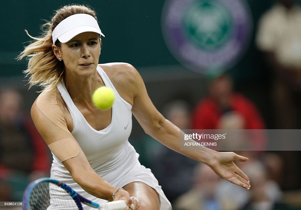 Bulgaria's Tsvetana Pironkova returns to Switzerland's Belinda Bencic during their women's singles single round match on the third day of the 2016 Wimbledon Championships at The All England Lawn Tennis Club in Wimbledon, southwest London, on June 29, 2016. / AFP / ADRIAN