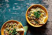 Plates of refreshing summer bulgur salad with fresh vegetables