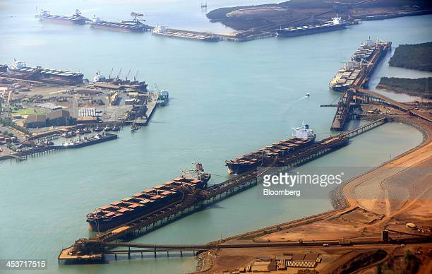 Bulk carriers are loaded with iron ore at the ship loading facility at Fortescue Metals Group Ltd's Herb Elliott Port in Port Hedland in the Pilbara...