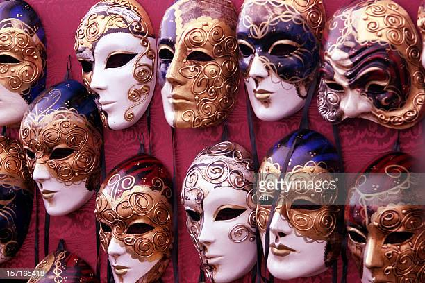 Bulk of venetian masks hanging in a row