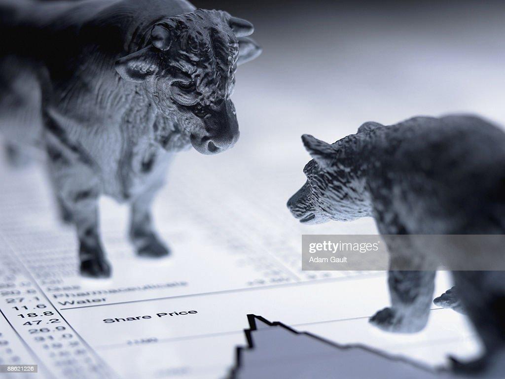 Bull and bear figurines on list of share prices : Stock Photo