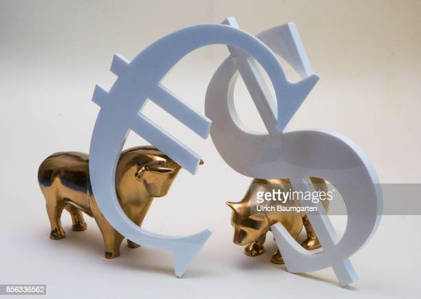 Bull and bear symbol for the ups and downs at the stock markets of the world The photo shows bull and bear with euro and dollar logo