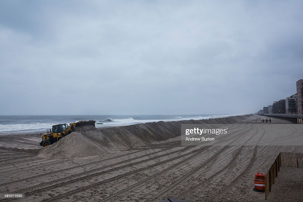 A bull dozer builds sand berms on the beach in preperation for Hurricane Joaquin on October 2 2015 in Long Beach New York The category 4 storm is...